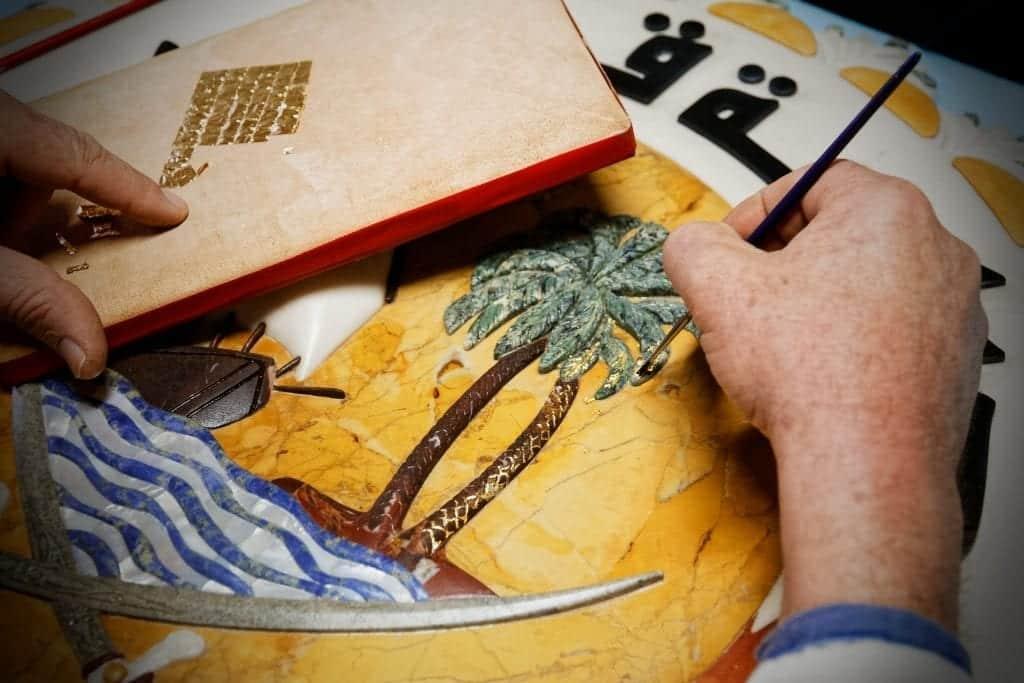gold leaf apply emblem qatar
